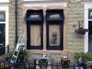 spraying white upvc windows black