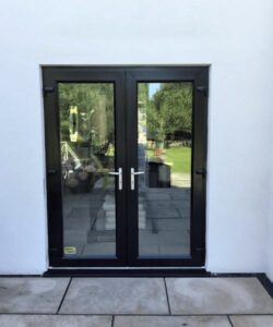 spraying white upvc patio doors black