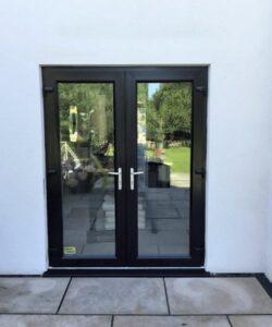 spraying white upvc patio doors black