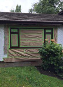 masking up prior to spraying exterior upvc