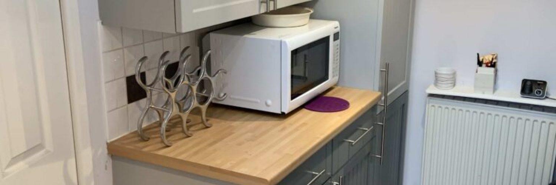 Spraying Kitchen Cupboards