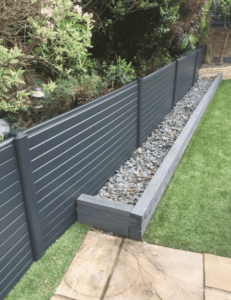 spraying faded brown upvc fence panels anthracite grey