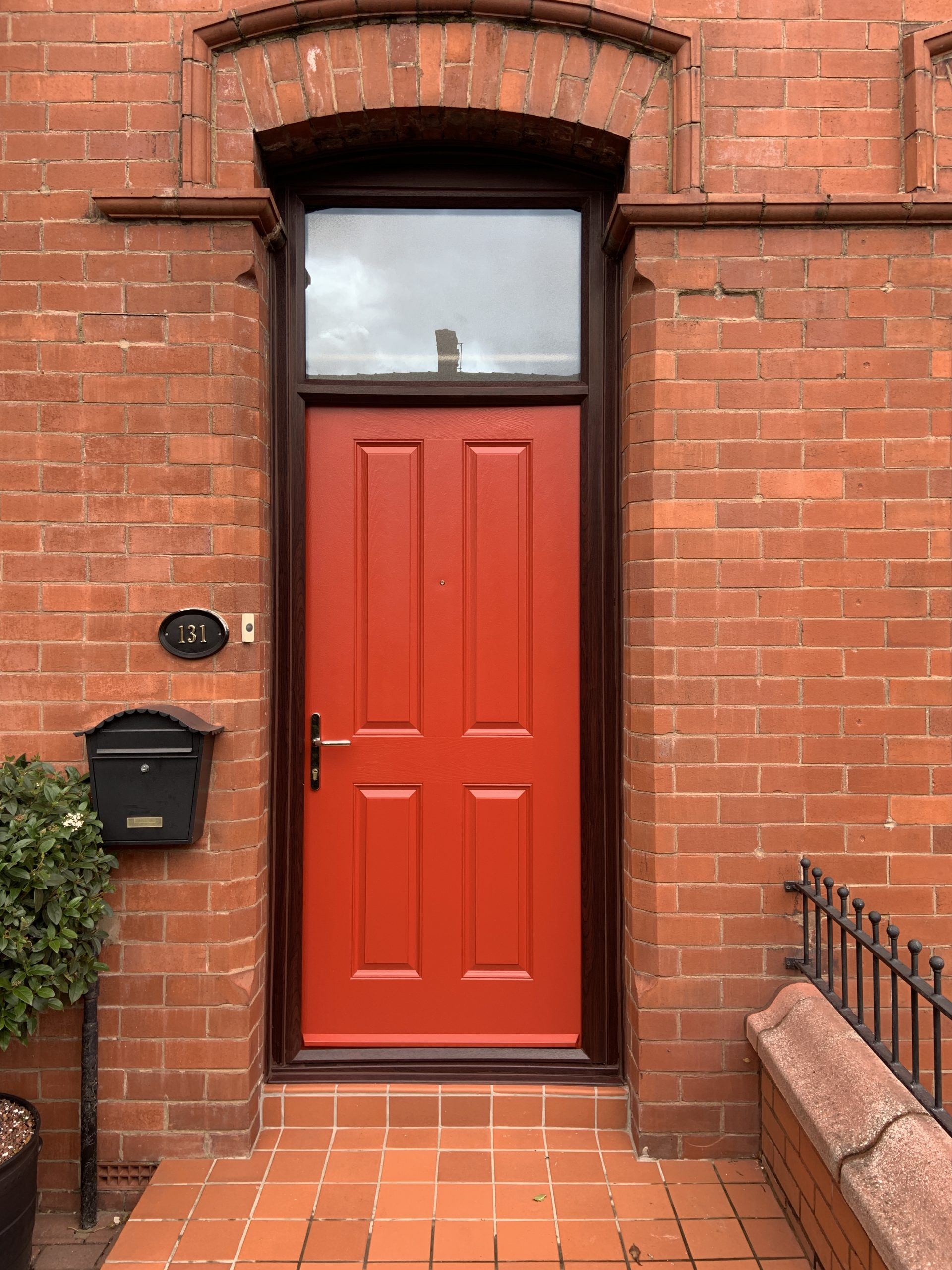 spraying composite door red
