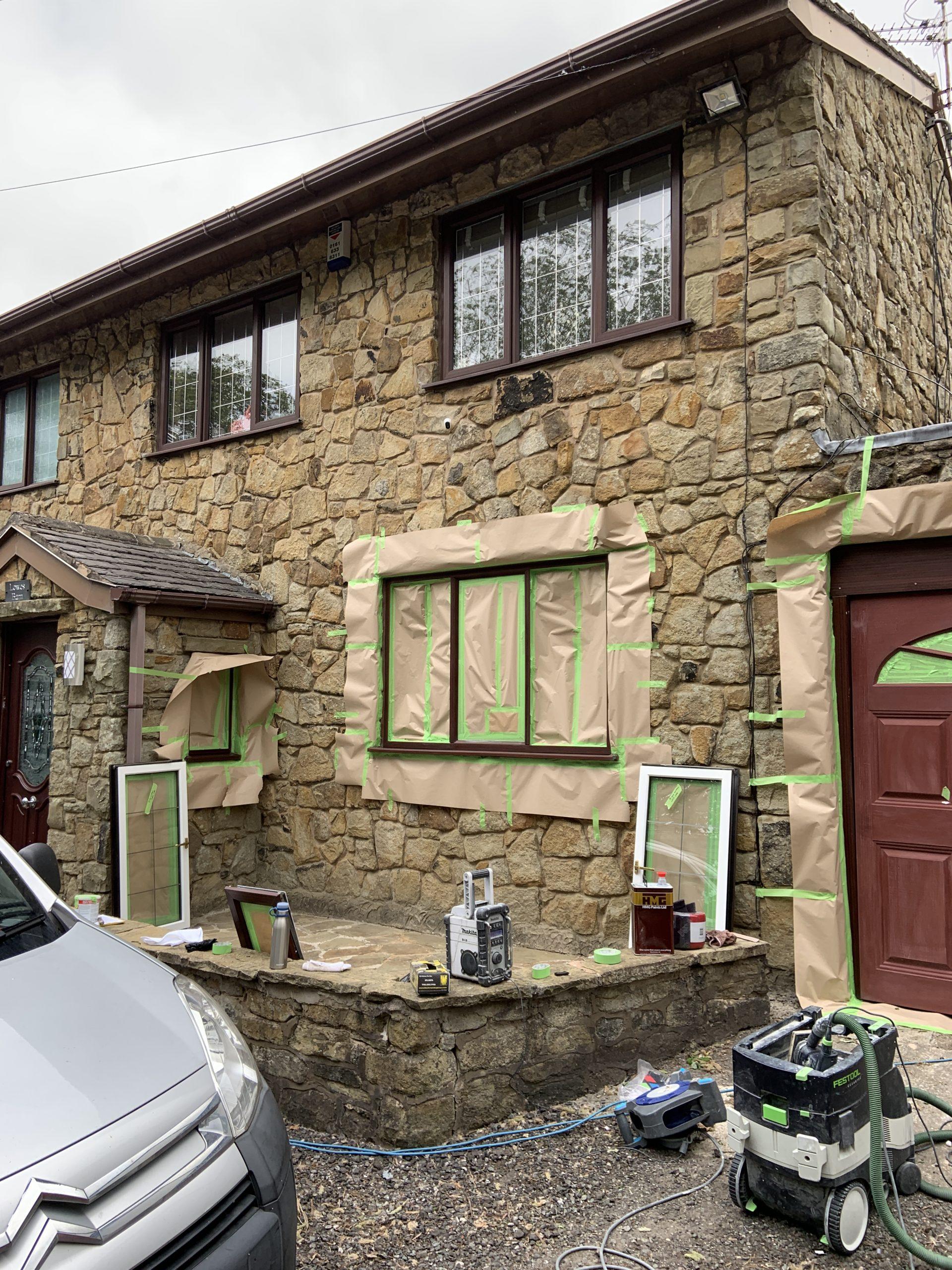 spraying rosewood windows